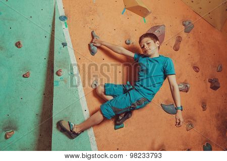 Climber Boy Training In Gym