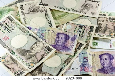 Background Of Asian Currency  (chinese Money Yuan And Japanese Yen)