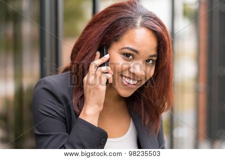 Young Afro-american Businesswoman Calling On Phone