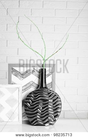 Modern vase with decor on floor in room