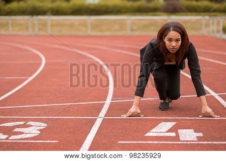 Businesswoman In A Start Position On Race Track