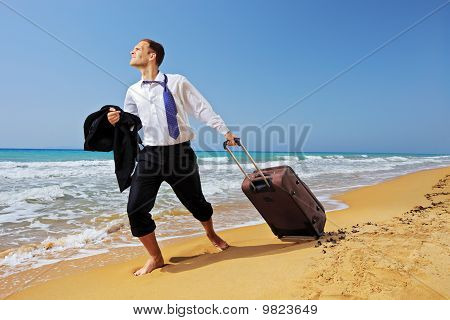 Full Length Portrait Of A Lost Businessman Carrying A Suitcase