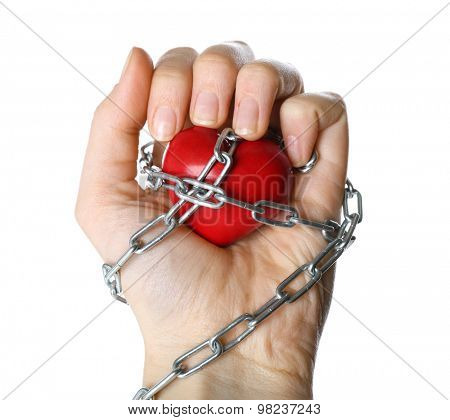 Heart shape with metal chain in female hand, isolated on white