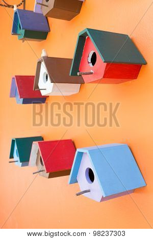 Colorful Bird Nest Wood Box Decorated On Orange Wall Background