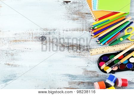 Colorful school stationery on wooden background
