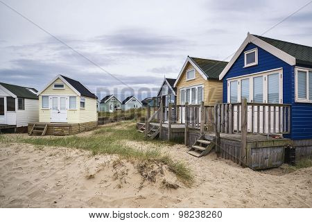 Lovely Beach Huts On Sand Dunes And Beach Landscape