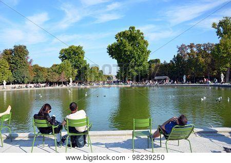 PARIS, FRANCE - SEPTEMBER 9, 2014: Paris - Local and Tourist in famous Tuileries garden. Tuileries Garden (Jardin des Tuileries) is a public garden located between the Louvre  and the Place de la Concorde. France.