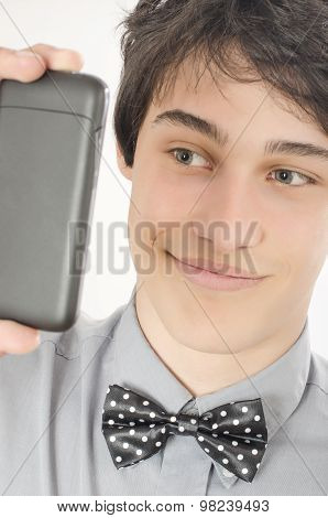 Conceited Businessman Taking A Selfie Photo With His Smart Phone.