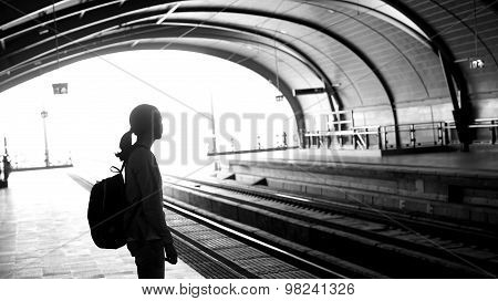 Silhouette For Tourist Girl Backpacker Waiting For Train At The Open Station, Travel Abstract