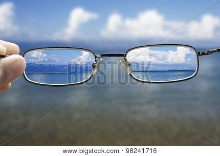 looking at the sea through the glasses
