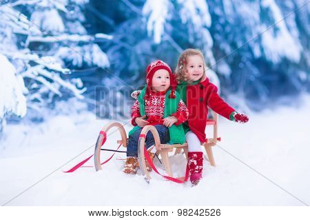 Kids Enjoying Sleigh Ride On Christmas Day