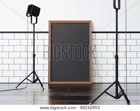 Black poster on the floor and two lamps, black floor. 3d rendering
