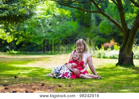 Beautiful Woman And Little Girl Having Picnic In A Park