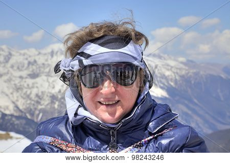 Dombay. Woman In Glasses From The Sun On A Background Of Mountains