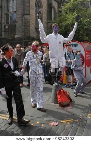 EDINBURGH- AUGUST 8: Members of Gardyloo publicize their show The Dream Sequentialists during Edinburgh Fringe Festival on August 8th, 2015