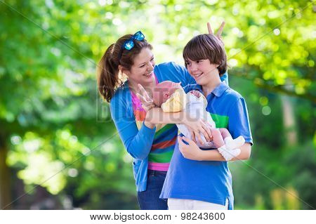 Young Mother With Two Kids In A Park