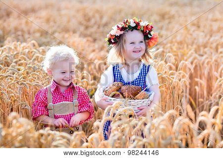 Kids In Bavarian Costumes In Wheat Field