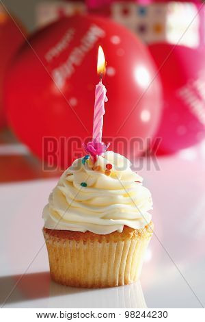 Close Up Of Vanilla Buttercream Cupcake With Birthday Candle