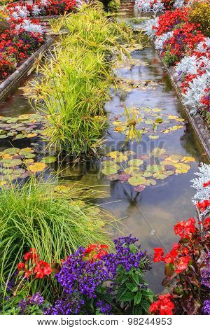 Small pond, overgrown with flowers. Delightful landscaped and floral park Butchart Gardens on Vancouver Island
