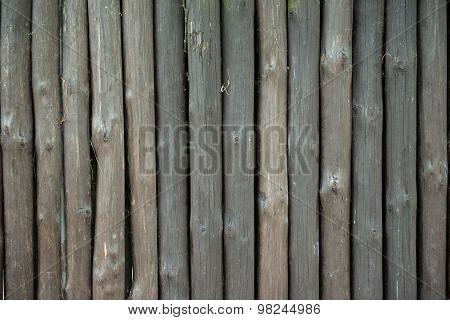 wooden bacground. Brown, vertical, long, irregular beams