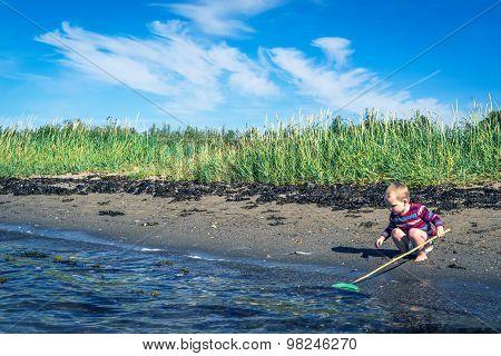 Boy Fishing At The Beach
