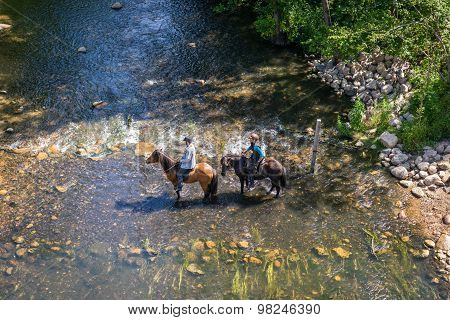 Horse Riders Trying To Croos A River