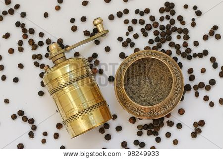 Brass pepper mill.