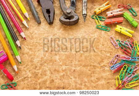 Tools, Pencil And Paperclips On Old Paper Background