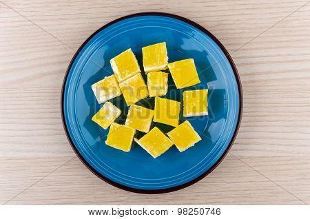 Yellow Turkish Delight In Blue Glass Plate On Wooden Table
