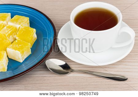 Yellow Turkish Delight In Blue Plate And Cup Of Tea
