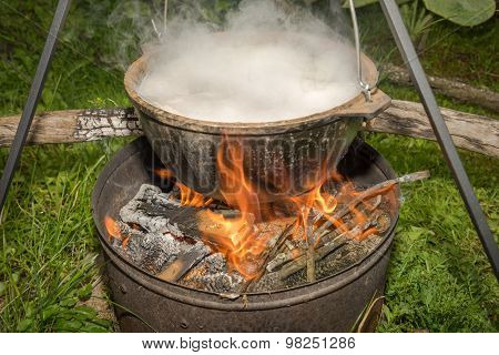 Cooking In Field Conditions, Boiling Pot At The Campfire On Picnic.