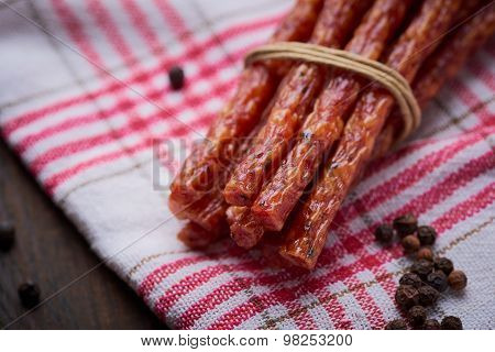 Sausage Or Kabanos And Pepper On Vintage Wooden Boards