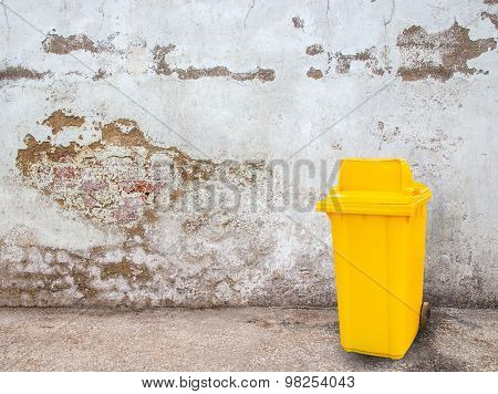 Yellow Garbage Bins On Grunge Background
