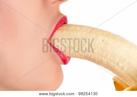 beautiful sexy female lips with a banana