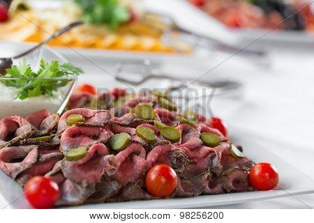 Slices of freshly prepared roast beef on a plate