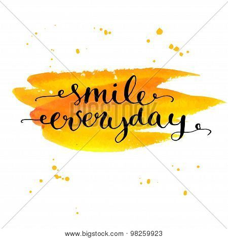 Insirational quote be smile everyday. Black ink modern calligraphy on yellow brush stroke.