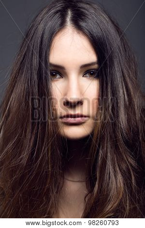 Portrait Of Pretty Young Woman Posing In The Studio Photo.