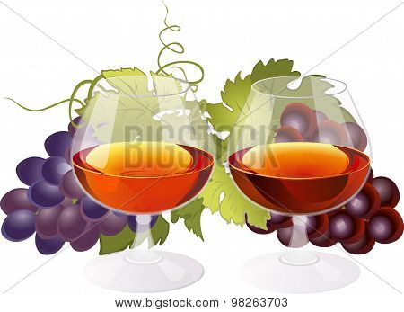 Composition with glasses of brandy and grapes.