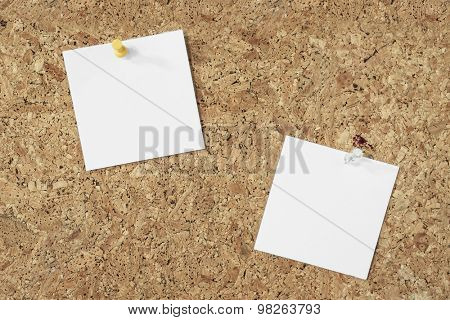 blank note paper pinned on a cork background