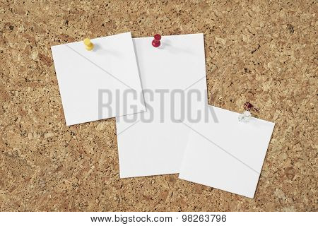 blank paper notes pinned on a cork background