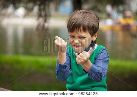 Childrens aggression, Portrait of little boy outdoor at the summer day