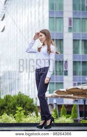 Portrait in full length, young business woman in white shirt on summer street city