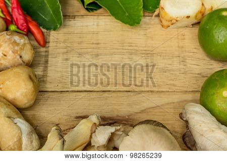 Thai food ingredients is lime, mushroom, chilli on wood background