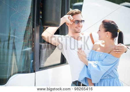Cheerful man and woman are enjoying their journey