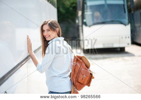 Attractive young woman is traveling by public transport