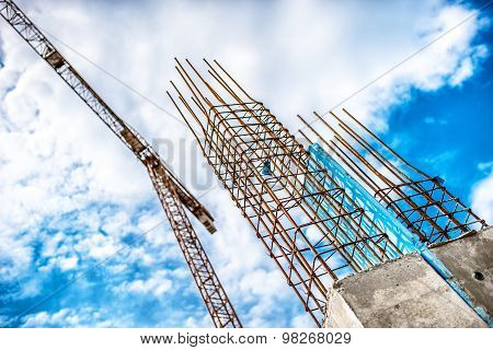 Concrete Pillars On Industrial Construction Site. Building Of Skyscraper With Crane, Tools