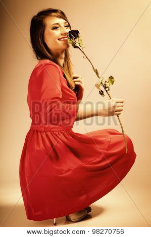 Fashion Woman Teen Girl In Red Gown With Dry Rose.