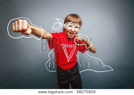European-looking boy of ten years shows a fist, anger, danger, m