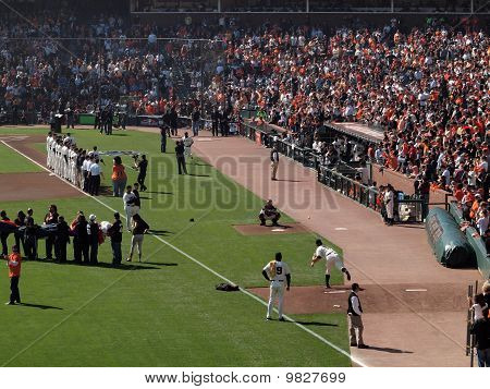 Giants Matt Cain Throws In The Bullpen To Catcher Buster Posey To Warm Up As Players Are Introduced