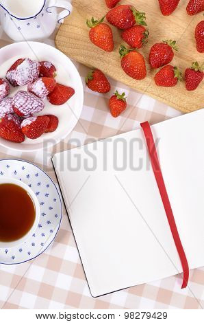 Strawberries With Blank Recipe Book And Check Tablecloth